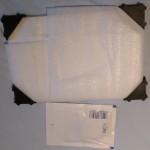 snapfish-Verpackung des Posters hinter Acrylglas